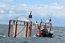 The mesocosm systems developed in Kiel at the Baltic Sea at Booknis Eck. Photo: U. Riebesell, IFM-GEOMAR